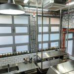 Индустриален интериорен дизайн на кухня, бели плочки с видими тухли и декорации, дизайнерска стълба, видими инсталации, НП Архитекти