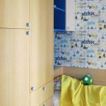 Classic interior design of a colorful child's boy room with modern accents and wallpaper in apartment DNBD01 by NP Architects