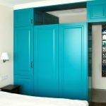 Classic interior design of a bedroom with colorful wardrobes in apartment DNBD01 by NP Architects