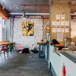 Modern lighting fixtures, decorations, exposed painted bricks, exposed installations, open-space, modern colorful furniture , Industrial interior design, Gelato&Latte shop, NP Architects
